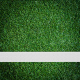 White stripe on the green soccer field Stock Photo