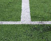 White stripe on green soccer field from top view stock photo