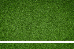 White stripe on the green soccer field from top view Stock Photo