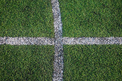White stripe line on the green grass field Stock Photos