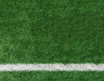 White Stripe Line at The Corner on Artificial Green Soccer Field as Copyspace to input Text from Top View used as Template Royalty Free Stock Image