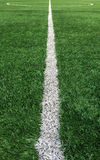 White Stripe Line to Center of The Green Soccer Field used as Template Stock Photography