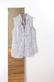 White striped blouse hanging on a mirror Royalty Free Stock Photos
