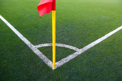 White stripes and corner flag on soccer field. The white stripes of corner kick in soccer field Stock Photo