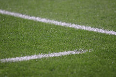 White stripes on the green soccer field Royalty Free Stock Photo