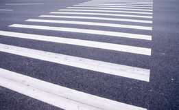 White stripes of a zebra crossing Stock Photos