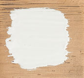 White stroke paint. On old wooden background Stock Photography