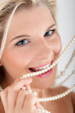 White strong teeth and pearls Stock Photo