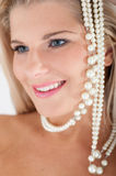White strong teeth and pearls Royalty Free Stock Image