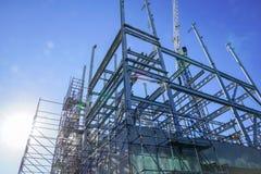 Structural steel framework for new building. White structural steel framework for new building against deep blue sky stock photos