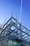 Structural steel framework for new building. White structural steel framework for new building against deep blue sky stock photo