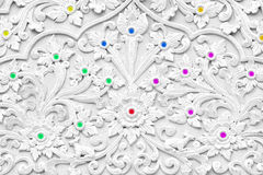 White stucco design of native thai style. On the Wall royalty free stock photo