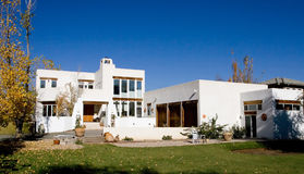 White Stucco Home. In Autumn Royalty Free Stock Image