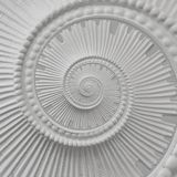 White stucco moulding plasterwork spiral abstract fractal pattern background. Plaster abstract spiral effect background. White spi Stock Photography
