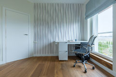 White study room. White spacious study room with wooden parquet and stripes on the wall Stock Photo