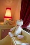 White stuffed bear. A white stuffed bear on a shelf in a child's room royalty free stock images