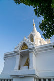 White stupa and buddhist statue Royalty Free Stock Photography