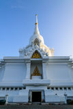 White stupa and buddhist statue Royalty Free Stock Images