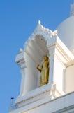 White stupa and buddhist statue Stock Photography