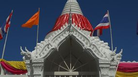 White stupa draped in red fabric stock video