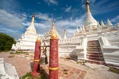 White stupa near Maha Aung Mye Bon Zan Monastery. Royalty Free Stock Images