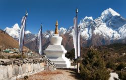 White stupa, prayer flags and himalayas Stock Image