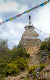 White stupa and praying flags Stock Photo