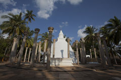 White stupa surrounded by pillars in Mihintale, Sri Lanka. Asia Stock Photo