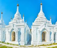 The sacred place in Mandalay, Myanmar. The white stupas of Kuthodaw Pagoda are the houses for the marble tablets with inscriptions from Trapitaka, the sacred royalty free stock photography