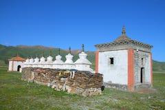 White stupas and prayer wheel buildings on Tibetan Plateau. Qinghai, China Stock Photography
