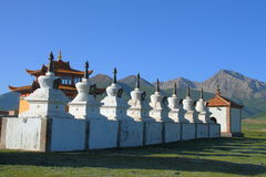 White stupas and prayer wheel buildings on Tibetan Plateau Stock Image