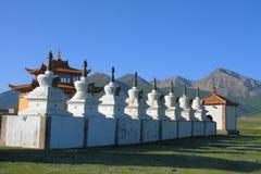 White stupas and prayer wheel buildings on Tibetan Plateau. Qinghai, China Stock Image