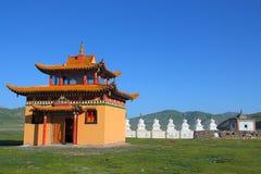 White stupas and prayer wheel buildings on Tibetan Plateau. Qinghai, China Royalty Free Stock Photo