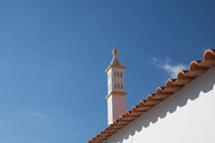 White stylish arabesque chimney on rooftop in blue sky Royalty Free Stock Image