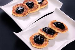 Cottage cheese pancakes on two white stylish plates stock photos