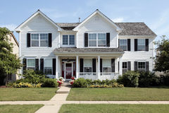 White suburban home with front porch. White home in suburbs with front porch Stock Photography