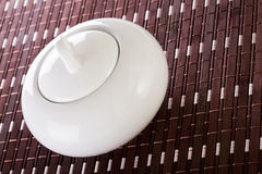 White Sugar Bowl on Placemat Royalty Free Stock Images