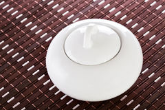 White Sugar Bowl on Placemat Royalty Free Stock Image