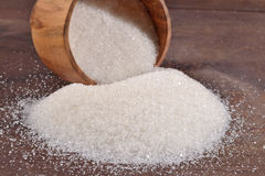 White sugar in a bowl. White sugar in a wooden bowl stock photos