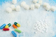 Sugar with capsules. White sugar with colourful capsules stock images