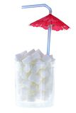 White sugar cubes with Cocktail Umbrella Royalty Free Stock Images