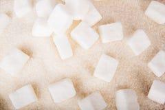 White sugar cubes and crystal sugar Stock Photo