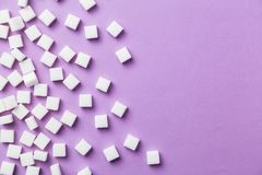 White sugar cubes on magenta background Royalty Free Stock Image
