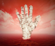 White sugar cubes shaped as human hand floating in blood Royalty Free Stock Images