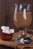 White sugar with a glass of coffee with milk Stock Photography