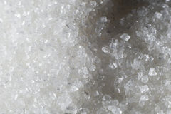 White sugar scattered on the table. Stock Photos