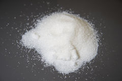 White sugar scattered on the table. Stock Photography