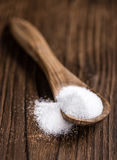 White Sugar (selective focus) on wooden background Royalty Free Stock Photography