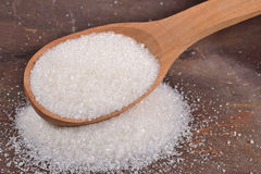 White sugar in a spoon Stock Images