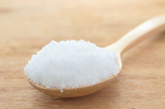 White sugar in wood spoon on wood table Stock Photo